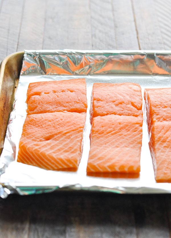 Salmon fillets on baking sheet