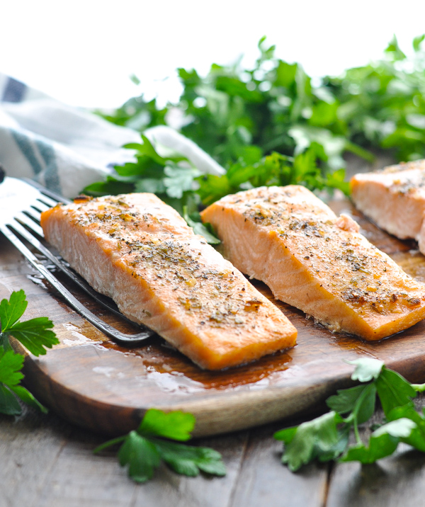 Front shot of baked salmon fillet on a spatula on a cutting board