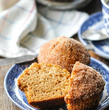 Front shot of cinnamon muffins on a blue and white plate