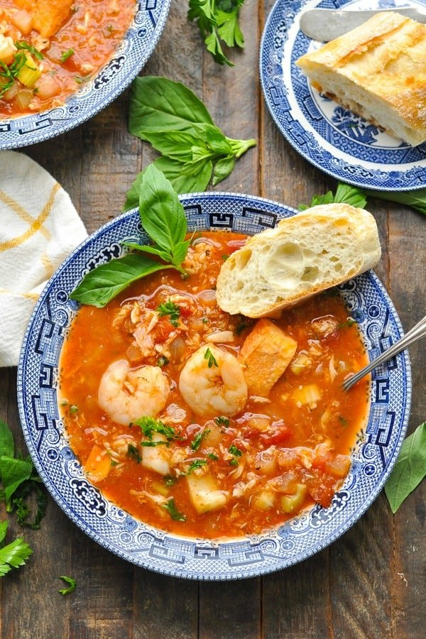 Close overhead shot of a bowl of cioppino recipe with fresh seafood
