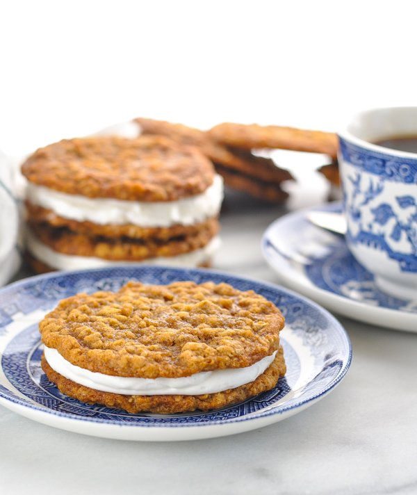 Oatmeal creme pie on a plate with others in the background