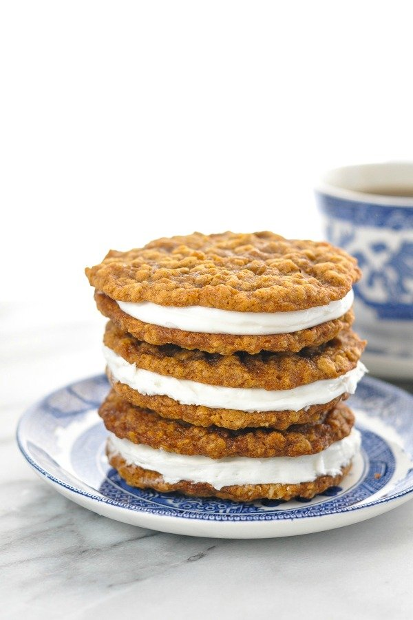 Close up front shot of three oatmeal cream pies stacked on a small plate