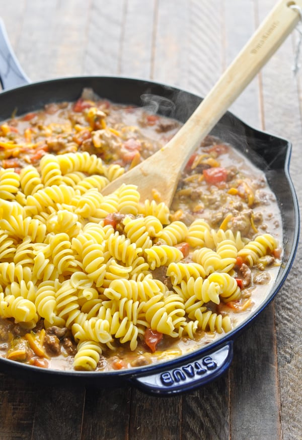 Adding pasta to skillet with ground beef