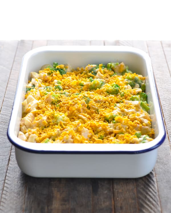 Chicken Divan casserole assembled in a white baking dish before baking