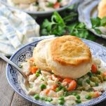 Close front shot of Crock Pot Chicken Pot Pie in a blue and white bowl