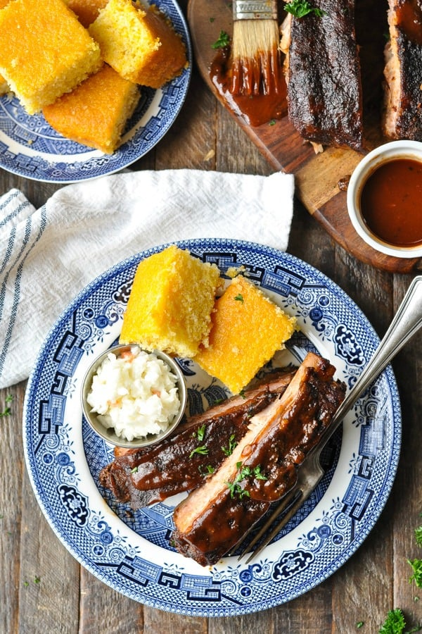 Close overhead shot of crock pot ribs on a blue and white plate
