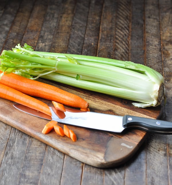Cutting carrots and celery on a wooden cutting board