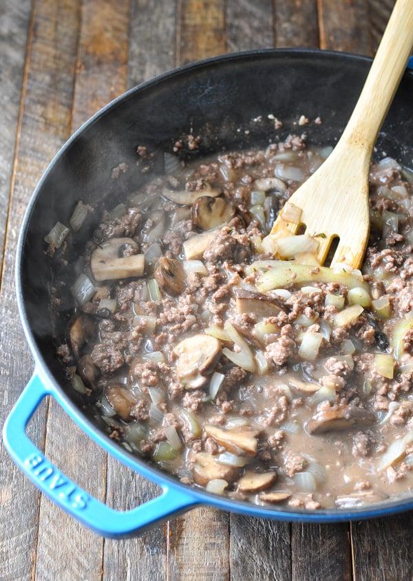 Ground beef stroganoff sauce in a cast iron skillet