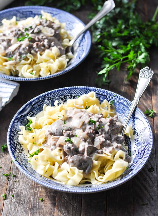 Front shot of ground beef stroganoff in a bowl with fresh parsley on top