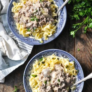 Overhead shot of two bowls of ground beef stroganoff with noodles