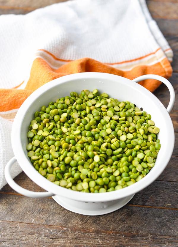 Rinsing split peas in a colander