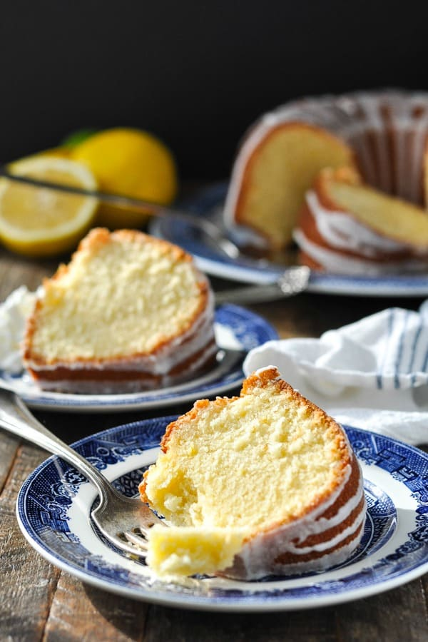Two slices of 7up pound cake on plates with forks
