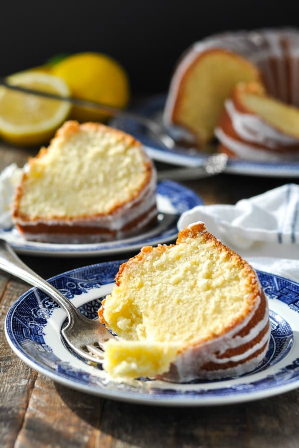 Close front shot of lemon pound cake on a plate with a bite on a fork