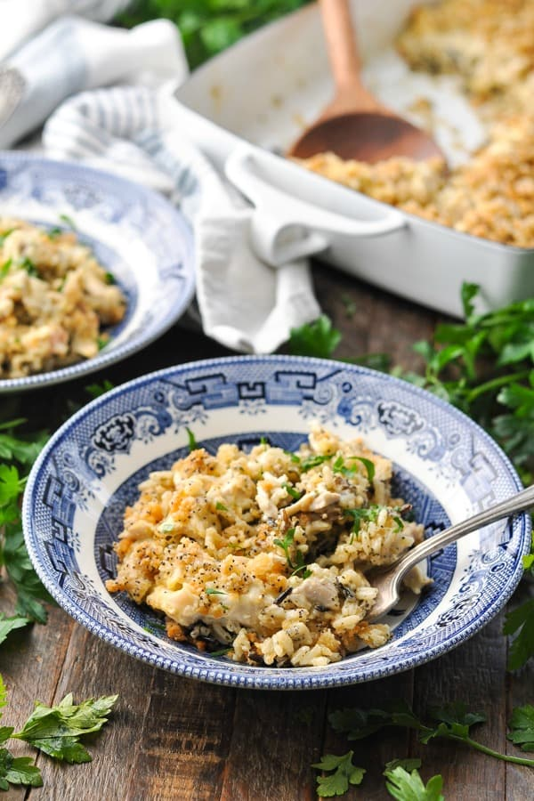 Front shot of chicken and wild rice casserole in a blue and white bowl