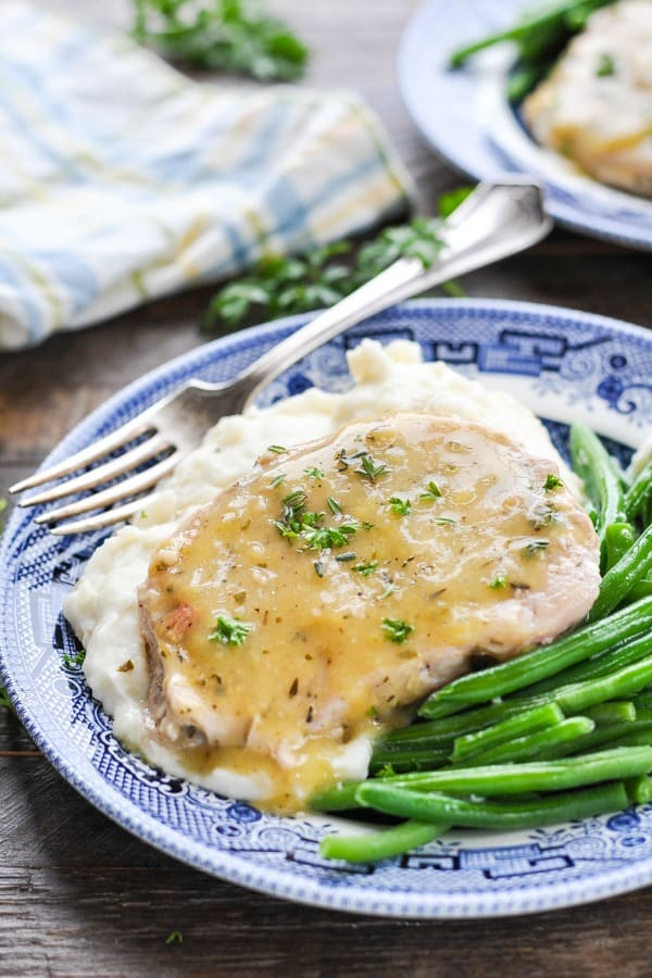 Close up front shot of slow cooker pork chops smothered in gravy