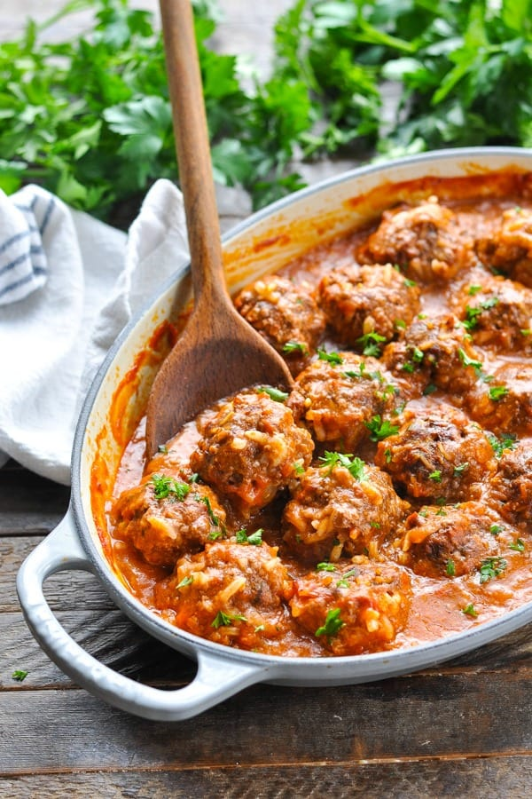 Baked porcupine meatballs in a gray cast iron dish