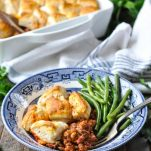 Sloppy Joe Casserole with biscuits on top served with green beans