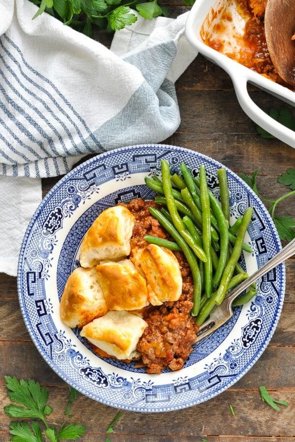 Close overhead shot of sloppy joe casserole on a wooden table