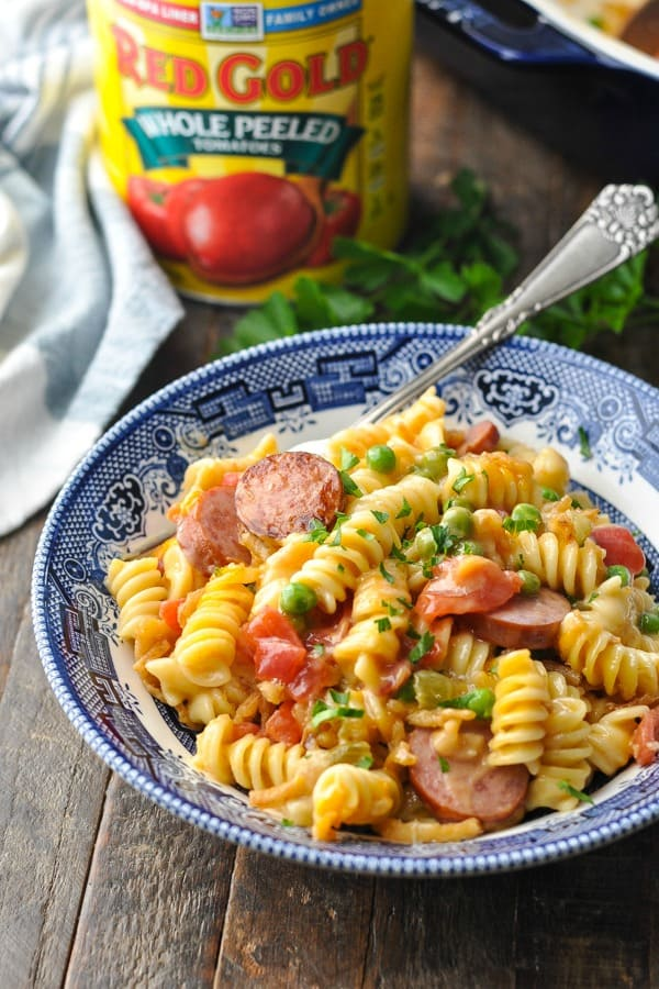 Front shot a bowl of smoked sausage pasta on a wooden surface