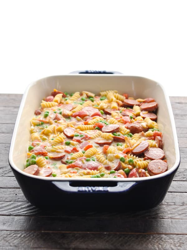 Smoked sausage pasta in a casserole dish before baking
