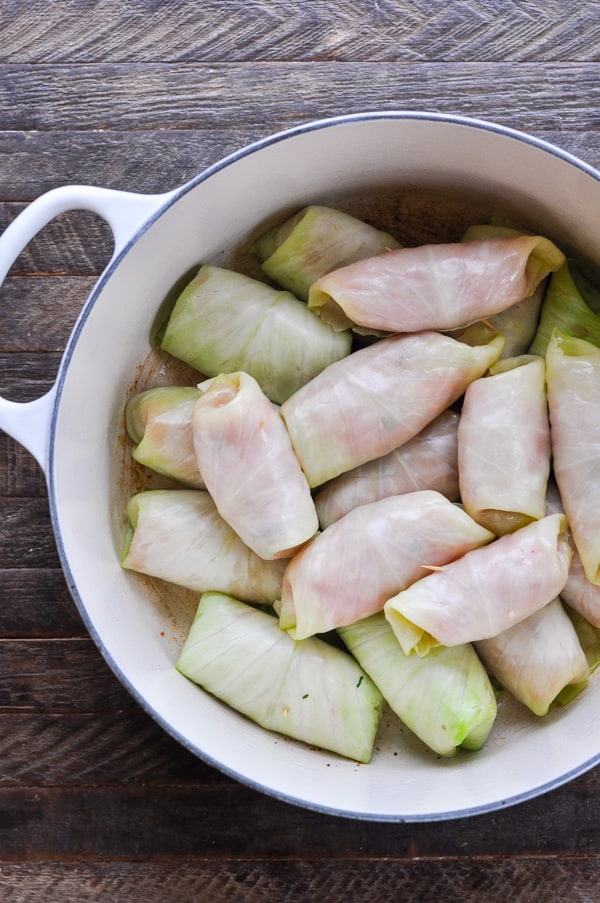 Stuffed cabbage rolls in a big Dutch oven before cooking