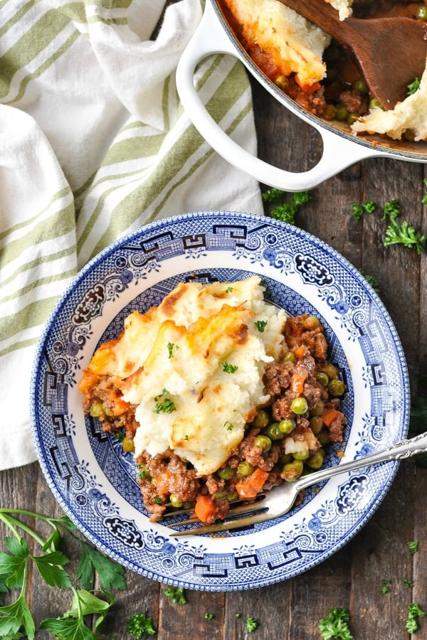 Close overhead shot of cottage pie with mashed potatoes on a plate