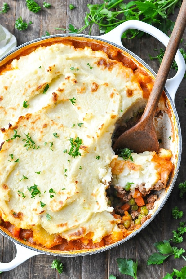 Close up shot of cottage pie in a white cast iron skillet