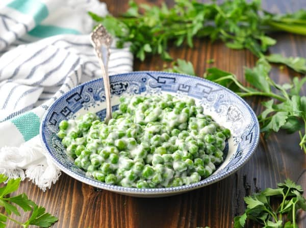 Horizontal image of a bowl of creamed peas