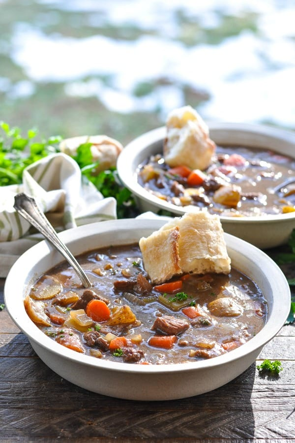 Two bowls of Irish Stew on a wooden surface