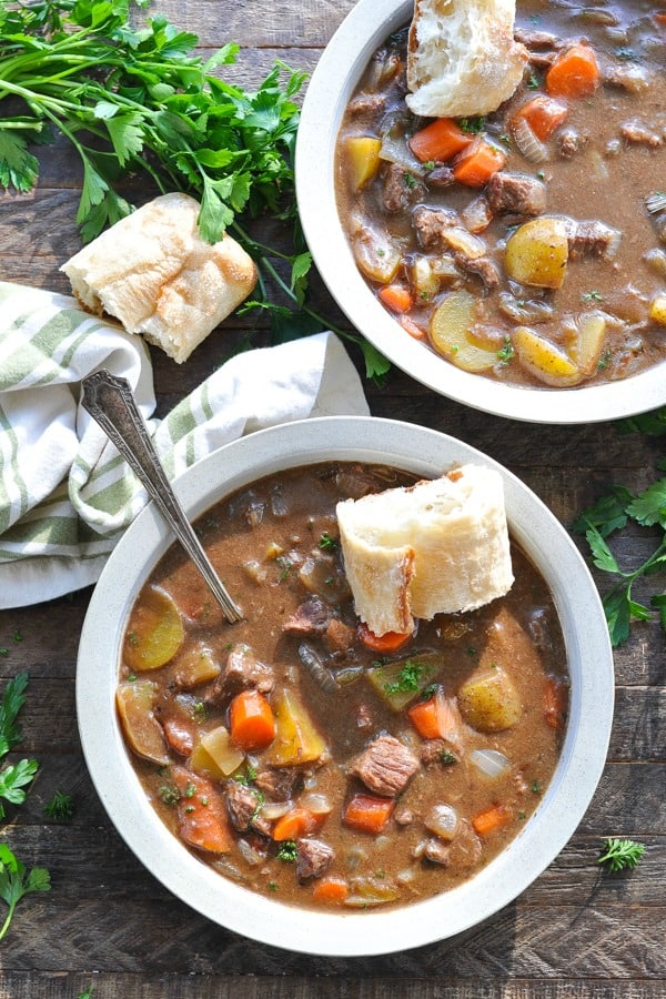 Overhead shot of Irish Stew served with French baguette