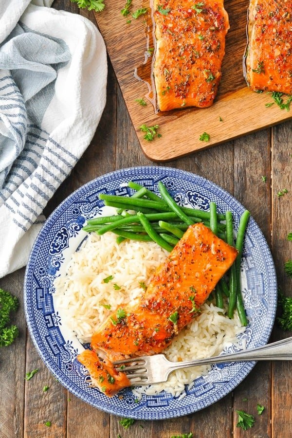 Overhead shot of glazed salmon on a plate with green beans and rice