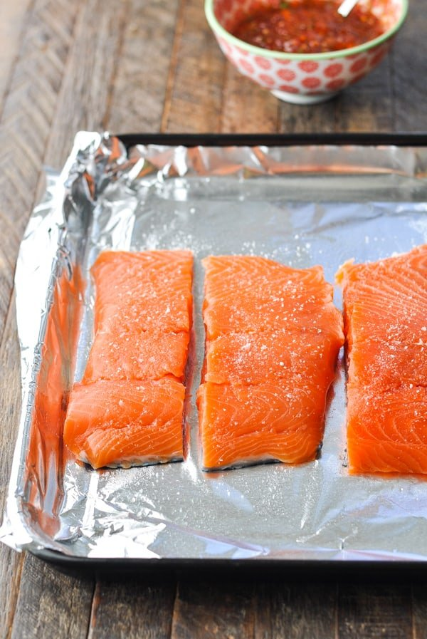 Salmon fillets on a foil lined baking sheet
