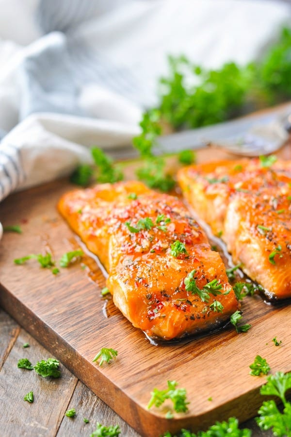 Baked salmon fillets on a cutting board