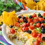 Front shot of 7 layer bean dip with tortilla chips in it