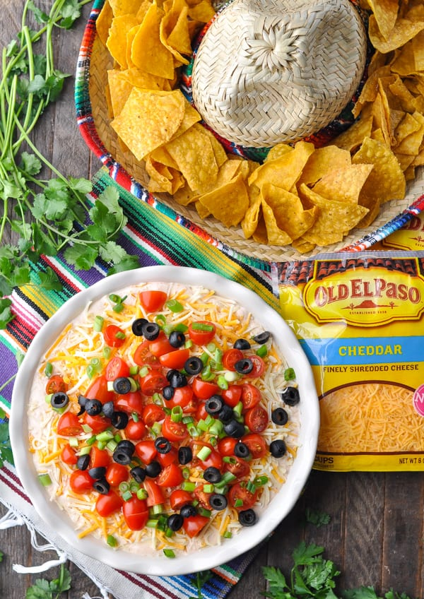 Overhead shot of bag of Old El Paso shredded cheese alongside a 7 Layer Bean Dip