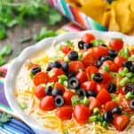 Close front shot of Mexican 7 Layer Dip in a white dish