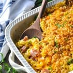Side shot of ham and cheese pasta casserole in a white dish