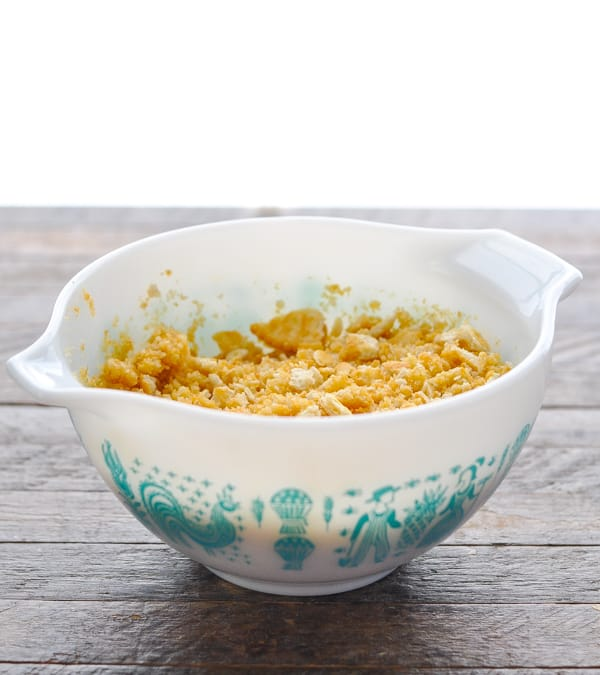 Ritz cracker crumb topping for a casserole in a white bowl