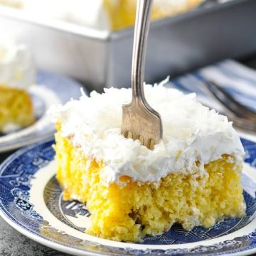 Fork digging into a slice of easy moist coconut cream cake