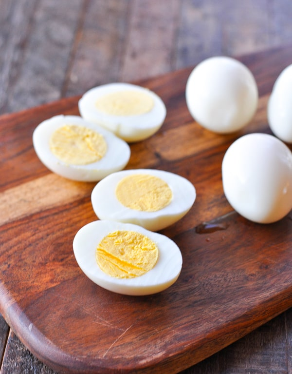Hardboiled eggs on a cutting board