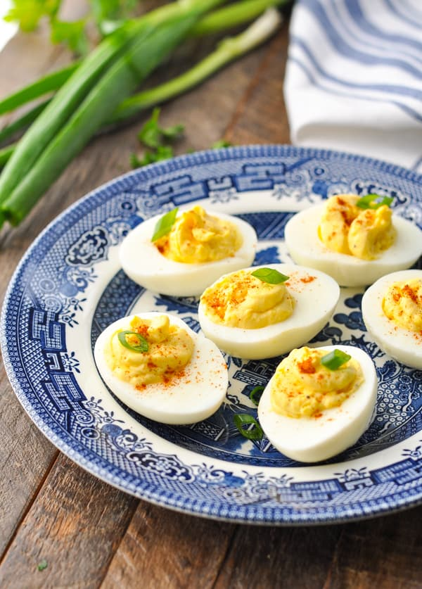 Close up front shot of deviled eggs on a blue and white plate