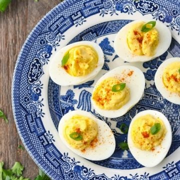 Close overhead shot of easy deviled eggs on a blue and white plate