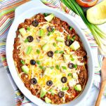 Overhead shot of healthy enchilada casserole with ground beef in a baking dish