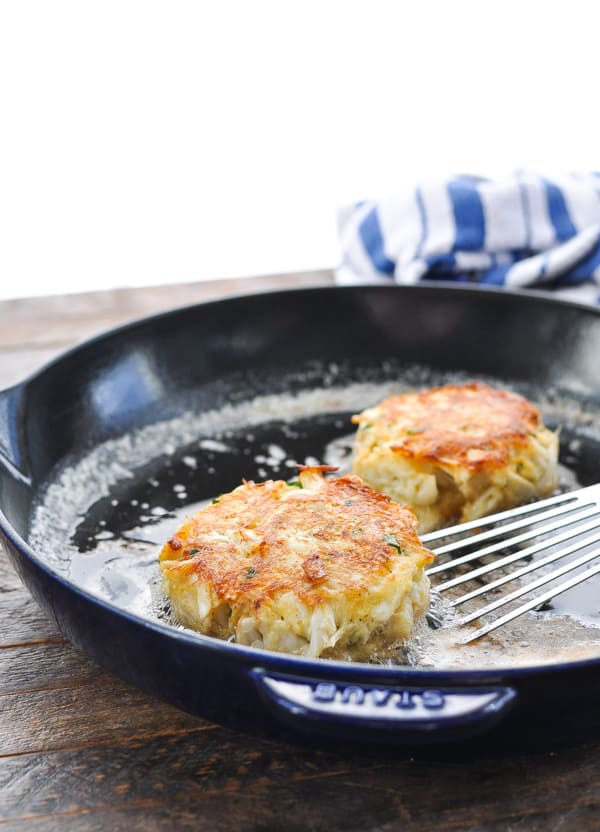 Pan frying crab cakes in a cast iron skillet