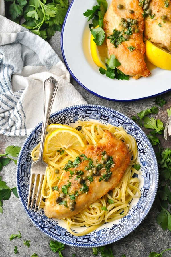 Blue and white pasta bowl full of healthy lemon chicken piccata