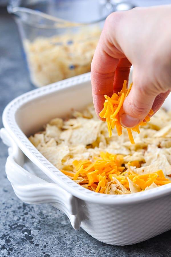 Process shot of assembling nacho casserole