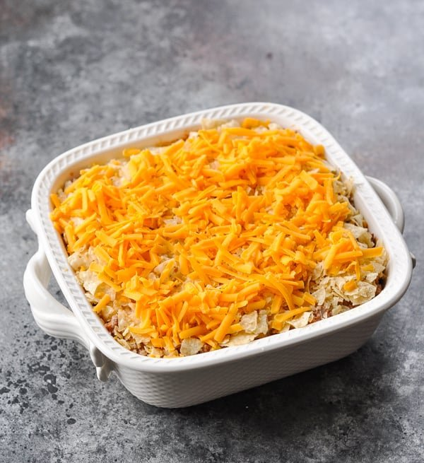 Nacho casserole in a white baking dish before going in the oven