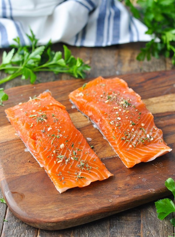 Raw salmon fillets on a cutting board