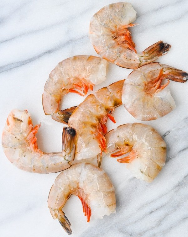 Raw jumbo shrimp on white marble