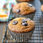 Baked banana muffin with chocolate chips on a cooling rack